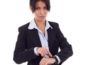 angry business woman pointing her watch